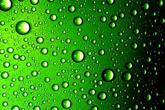 Water drops closeup. Abstract green background Stock Photos