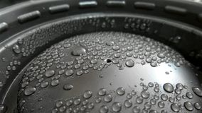 Water drops on coffee cup cover Royalty Free Stock Photos