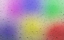 Water drops on color background Stock Photography