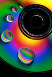 Water drops and colors on CD. Water drops on a CD with a rainbow of colors Royalty Free Stock Images