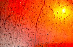 Water Drops Colourful Background Photograph. Beautiful and colourful water drops abstract background photograph with yellowish background Royalty Free Stock Photo