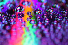 Water Drops. On a Compact Disc Royalty Free Stock Images