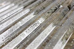Water Drops on Corrugated Roof royalty free stock images