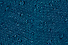 Water drops on a dark blue background. Stock Images