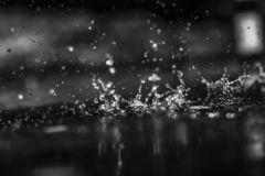 Water drops in the dark outside. stock image