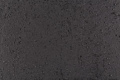 Water drops on dark stone Stock Photo