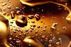 Water drops - deep gold stock photography