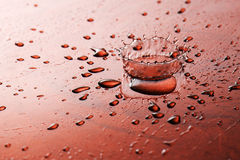 Water drops. Water droplets that fall on red stock images