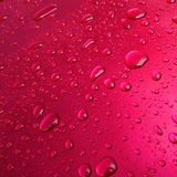 Water Drops and Droplets on Pink Paint Background Royalty Free Stock Photo