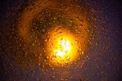 Water drops on the embossed surface and lighting Stock Image