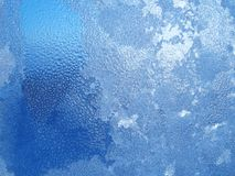Water drops end frost on window. Window glass with frost and drops Stock Photos