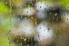 Water drops falling on a glass Stock Photo