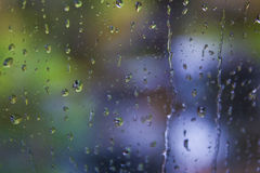 Water drops falling on a glass Royalty Free Stock Images