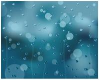 Water drops on glass. Blue water drops on glass surface Stock Photos