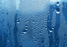 Water drops on glass. Large and fine water drops on glass Royalty Free Stock Photos