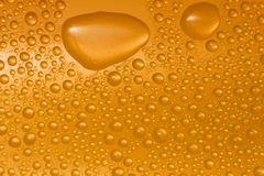 Water drops on glass. Gold. (Boss drops stock illustration