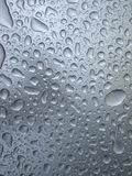Water drops on glass. Closeup of drops of water on glass surface Stock Images
