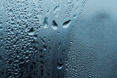 Water drops on glass. Large and fine water drops on glass Royalty Free Stock Photo