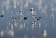 Water drops on glass with blur effect Stock Photos