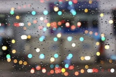 Water drops on glass with bokeh Royalty Free Stock Photos