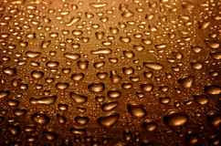 Water drops on glass, brown color Stock Photos