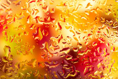 Water drops on glass with colorful background Royalty Free Stock Images