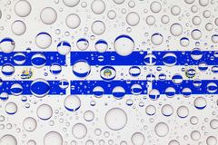 Water drops on glass and flags of El Salvador royalty free stock photography