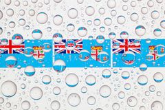 Water drops on glass and flags of Fiji Stock Photography