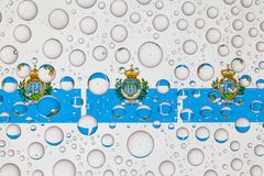 Water drops on glass and flags of San Marino royalty free stock photos