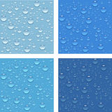 Water drops. Water drops on the glass in four different color modes Stock Image