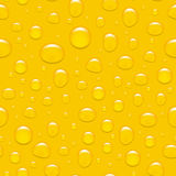 Water drops on glass. Like a beer. Seamless background. Stock Photos