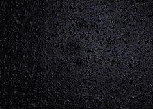 Water drops on glass. Little drops of water or bubbles on a black glass surface Stock Images