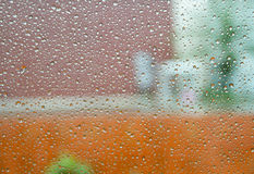 Water drops on glass and on nature background Stock Photography