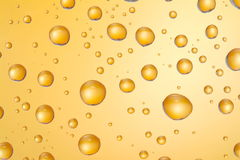 Water drops. Water drops on glass with orange lighting Royalty Free Stock Image
