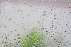 Water drops on the glass. Water drops on the glass after raining Stock Image