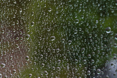 Water drops on the glass. Water drops spray on the glass surface Stock Photo