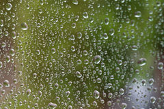 Water drops on the glass. Water drops spray on the glass surface Royalty Free Stock Image