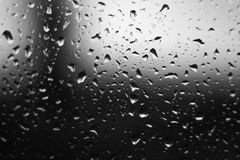 Water drops on glass. The window In rainy weather. Closeup Stock Photos