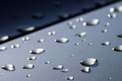 Water drops. Glistening raindrops after rain on board stock images