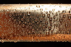 Water drops on golden metal Royalty Free Stock Photos