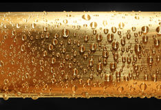 Water drops on golden metal Stock Photo