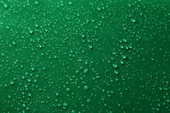 Water drops on green background, close up Royalty Free Stock Photo