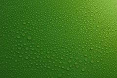Water drops on green background texture. Ecology for design Royalty Free Stock Images