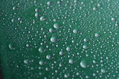 Water drops on green background texture. Pure drops of ecology protection of water resources, the preservation of fresh water stock photo
