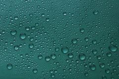 Water drops on green background texture. Pure drops of ecology protection of water resources, the preservation of fresh water royalty free stock photos