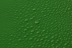 Water drops on green background texture. Ecology for design Royalty Free Stock Photos