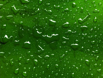 Water drops on green metallic Royalty Free Stock Photo