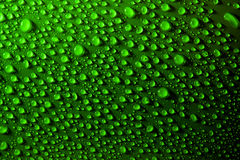 Water drops on green surface Stock Photo