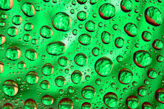 Water drops on the green surface Stock Photo