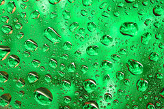 Water drops on the green surface Royalty Free Stock Images